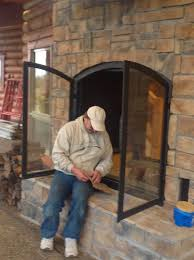 custom see through wood burning indoor outdoor fireplace