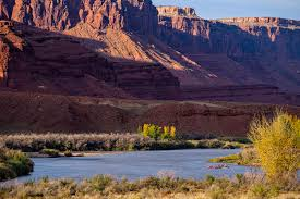 outdoor nature photography. Rafting The Colorado River Through Castle Valley Utah - Boaters Floating Very Scenic Canyons Landscape. Utah, USA Outdoor Nature Photography C