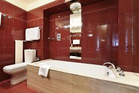 trendy red small master bathroom ideas with red ceramic wall and drop in wooden border bathtub