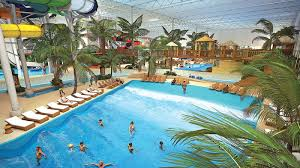 indoor pool with waterslide. A New Addition Slated To Open At Valcartier Vacation Village On Dec. 2 Is Sure Keep The Kids Happy. Cost Of More Than $65 Million, It Includes Indoor Pool With Waterslide