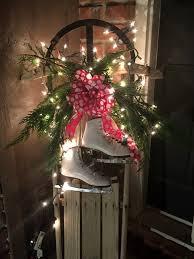 Weihnachtsdeko Schlitten Lichterkette Schleife Schlittschuhe