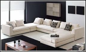 modern sofas and chairs. Sofas Living Room Furniture Beauteous Modern Sofa Sets For Roomwith Square Wooden Table With Black Carpet And White Floor Rack Cabinet Also Chairs