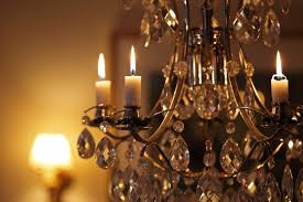 a close up of candles burning on a crystal chandelier