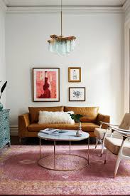 white marble coffee table via anthropologie tables we love with wheels oval sofa wooden legs top accent green end cost effect block side