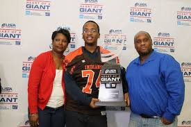 """Evan Engram of the NY Giants presents JFK Student Athlete Duane Coleman, II  with the """"Heart of a Giant"""" Award - Newark Board of Education"""