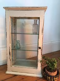 small vintage glass door display cabinet