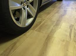 vinyltrax flooring tiles incorporate a premium quality vinyl insert within an interlocking polypropylene base the base features the same patented