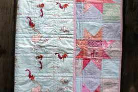 Everybody loves a wonky star…right….   WOMBAT QUILTS & pink backing fabric Adamdwight.com