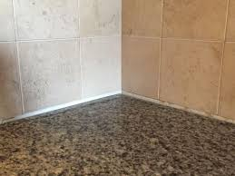 i m thinking grout or caulk won t look nice since the gab is large fluctuates in size in diffe areas any help on this issue would be greatly