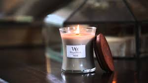 ling candle by woodwick candles for fireplace scented candle and wood table for home interior design also living room decoration with decorative