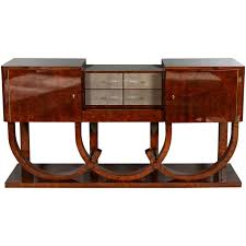 art deco style sideboard by german fine furniture maker cygal art deco made of burl walnut with four grey shagreen center drawers and brass hardware art deco era furniture