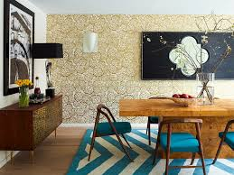 view in gallery stylish wallpaper brings golden elegance to the contemporary dining room design incorporated