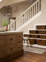 under stairs furniture. under stair storage with baskets could combine this the drawer idea maybe do two rows of drawers and then on top since it would be easier to stairs furniture