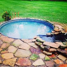 build a flagstone pavers deck around it and add a simple waterfall