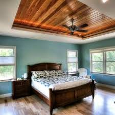 Turquoise Bedroom Features Warm Wood Tray Ceiling