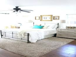 rug placement under bed area