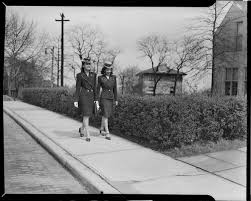 Myrna Aiken and Rosemarie Lawrence walking along sidewalk on Centre Avenue  by Falk School, University of Pittsburgh, Oakland | CMOA Collection