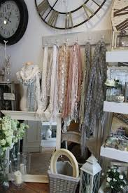 hanging scarves and a bustform. The color scheme looks lovely together