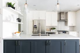 white kitchen with navy island view full size