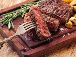 smoked ribeye steaks on wood pellet