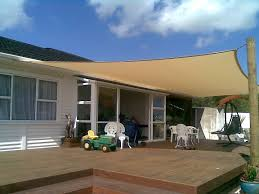 sun canopy for deck retractable deck shade modern canopy wooden floor white chairs