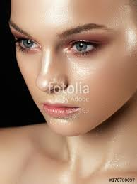 beautiful young woman with perfect clean shiny skin natural fashion makeup close up