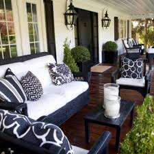 furniture for porch. In Black And White.fab Traditional Porch With Wicker Furniture White Cushions To Complement The House Exterior\u0027s Clapboard For V