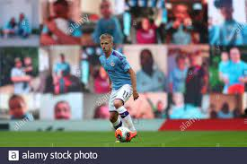 Manchester City's Oleksandr Zinchenko in front of the fan video wall during  the Premier League match at the Etihad Stadium, Manchester Stock Photo -  Alamy