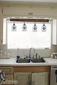 over the kitchen sink lighting ideas. four cage light idea over the kitchen sink lighting ideas
