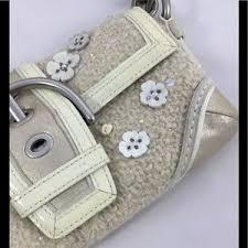 Coach Bags - Coach knit ivory   gold metallic flower appliqué