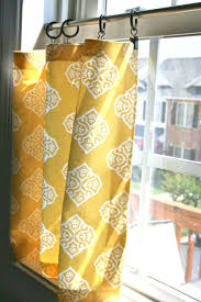 curtains stock photo yellow checked curtains on window above bed with cushions and yellow amazing