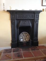 decorative cast iron fireplace surround and mantle