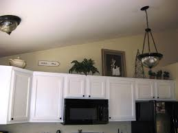 ... Kitchen How To Decorate Above Cabinets Dark Table Sets Black Iron Stove  Brown Color Granite Countertop ...