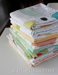 Image result for pile of quilt tops