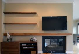 Wall Mounted Tv And Barn Wood Floating Shelves Over Fireplace Also  regarding Rustic Floating Shelves Tv