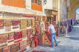 rug merchant bukhara uzbekistan april 28 2016 the rug merchant lay out the carpets next to rug merchant