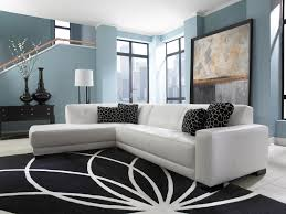 blue and white furniture. Mid Century White Leather Tufted Sectional Chaise Lounge Sofa Bed In Living Room With Light Blue Wall Interior Color And Black Carpet Tiles Under Stairs Furniture A