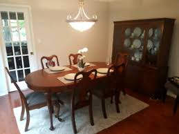 solid cherry dining room table with 6 chairs and a hutch