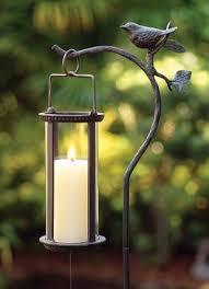 hanging lantern with bird velas de