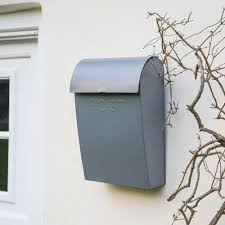 large grey wall mounted post box