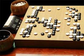 Game With Rocks And Wooden Board What Is Go American Go Association 65