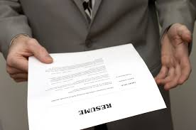A candidate holding a resume