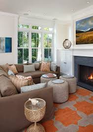 compact living room furniture. small living room with orange grey rug beige corner sofa wih pillows three brown compact furniture e