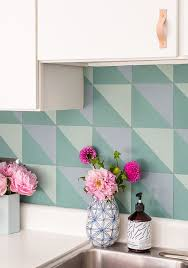 how to create a diy budget backsplash that mimics the look of cement tiles