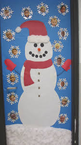 Bulletin Board Ideas: A very cute Frosty the Snowman classroom door display  that includes snowflakes with students' face in the middle of them.