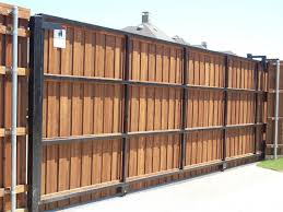 fascinate outdoor wood gates in sliding door type combine with black iron frame wood gates and concrete walkway design
