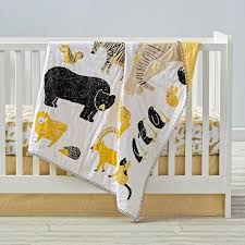 black and yellow animal print crib bedding and quilt