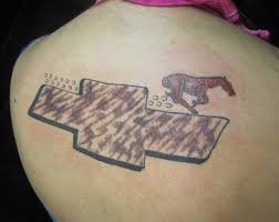 ford mustang logo tattoo. horse galloping over chevy logo the ugliest bad worst tattoos ford mustang tattoo