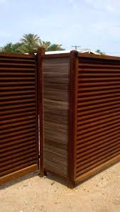 corrugated metal and wood fence corrugated steel fence diy wood framed corrugated metal fence