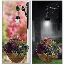 diy outdoor solar lighting ideas. solar lights for over hanging baskets. no tutorial but you can easily create the one diy outdoor lighting ideas